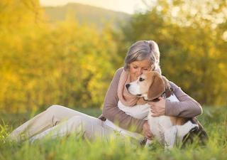 a woman hugs her dog | bone grafting medina oh