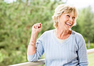Woman smiling with her dentures