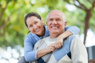 A couple smiles together | Dentures in medina oh