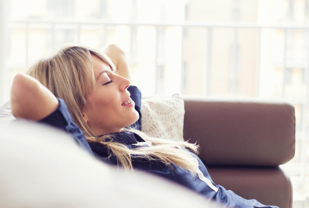 a woman relaxes in a chair | Medina OH dentist
