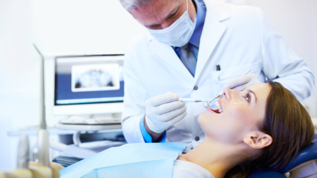A Woman Getting Her Dental Cleaning | Medina OH Dentist